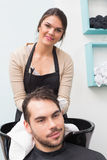 Hair stylist drying mans hair Stock Photos