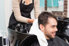 Hair stylist drying mans hair Stock Photo