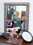 Hair stylist in hair salon. Hair stylist standing in hair salon with equipment Royalty Free Stock Images