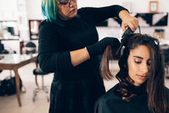 Free Hair Stylist Makes A Curls For Woman In Salon Stock Photography - 96132262