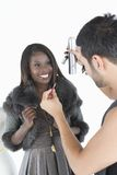 Hair Stylist Makes Adjustments To Model In Fur Jacket Stock Photo