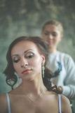 Hair stylist makes the bride Stock Photos