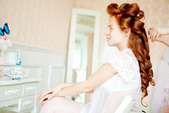 Hair stylist makes the bride on the wedding day Stock Photo