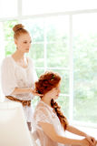 Hair stylist makes the bride on the wedding day Royalty Free Stock Image