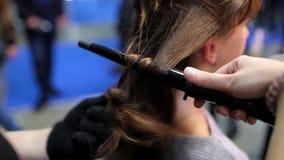 Hairdresser does hair stock video