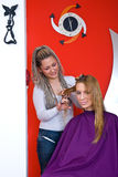 Hair stylist making haircut Royalty Free Stock Photography