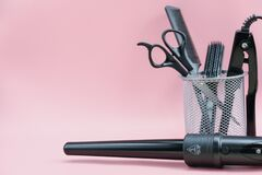 Free Hair Stylist Tools In A Basket. Scissors, Brush, Comb. Curling Iron Stock Photo - 206740960