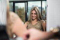 Hair Stylist Using Dryer On Woman In Salon Stock Photo