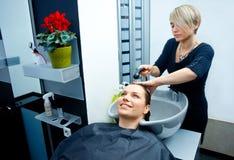Hair stylist washing hair Stock Photo