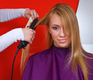 Hair stylist at work. Hair stylist work on woman in salon Stock Images
