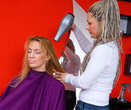 Hair stylist at work Royalty Free Stock Photos