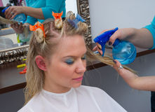 Hair stylist at work Stock Images