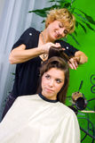 Hair stylist at work Royalty Free Stock Images