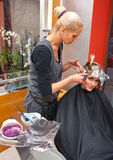 Hair stylist at work Stock Photo