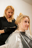 Hair stylist at work - hairdresser  applying a color on   custom Royalty Free Stock Photography