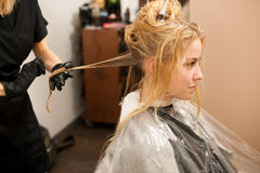 Hair stylist at work - hairdresser  applying a color on   custom Stock Image