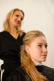 Hair stylist at work - hairdresser  and  customer evaluating hai Royalty Free Stock Photo