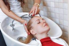 Hair stylist at work hairdresser Stock Photo