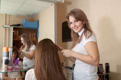 Hair stylist work on woman. Hair stylist work on women hair in salon Stock Image