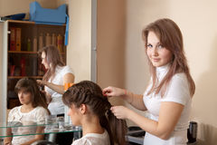 Hair stylist working with girl Royalty Free Stock Photos