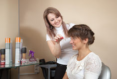 Hair stylist working with long-haired girl Stock Photos