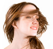 Hair in a Swirling Wind. Woman's hair are being blown away in a swirling wind royalty free stock photography