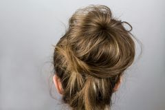 Hair tied in a bun stock photo