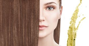 Hair treatment by oil therapy. Flying green olive splash. Over white background royalty free stock photos
