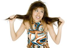 Hair Trouble. An attractive young asian woman is having hair trouble royalty free stock photography