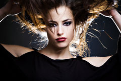 Hair up. Beautiful brunette with hair up, studio shot Stock Images
