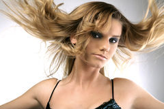 Hair up in the air. Fashion portrait of a girl with hair up in the air Royalty Free Stock Photo