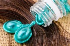 Hair vitamin serum capsule with damaged hair. Stock Images