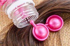 Hair vitamin serum capsule with damaged hair. Stock Photo