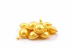 Hair vitamin serum capsule gold color. Royalty Free Stock Image