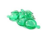 Hair vitamin serum capsule green color Stock Images