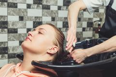 Hair wash procedure in a beauty salon stock image