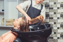 Hair wash procedure in a beauty salon royalty free stock image