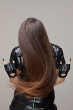 Hair wave. Woman with long hair covering her face Royalty Free Stock Photos