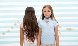 Hair wave or perm. hair wave or perm for brunette and blonde small girl. small girl kids at hairdresser. time stops when stock photography