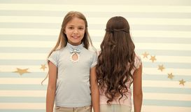 Hair wave or perm. hair wave or perm for brunette and blonde small girl. small girl kids at hairdresser. time stops when stock image
