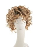 Hair wig over the mannequin head. Curly hair wig over the white plastic mannequin head isolated over the white background Stock Photos