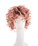 Hair wig over the mannequin head. Curly hair wig over the white plastic mannequin head isolated over the white background Royalty Free Stock Photos