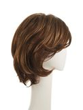 Hair wig over the mannequin head. Open wave hair wig over the white plastic mannequin head isolated over the white background Stock Image