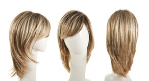 Hair wig over the mannequin head. Open wave hair wig over the white plastic mannequin head isolated over the white background, set of three foreshortenings Stock Image