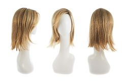 Hair wig over the mannequin head. Open wave hair wig over the white plastic mannequin head isolated over the white background, set of three foreshortenings Stock Images