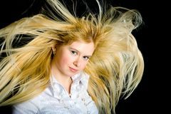 Hair on wild. The strong wind blows on the girl Stock Images