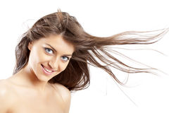 Hair in the wind. Smiling woman with long hair in the wind royalty free stock photos