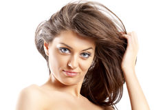 Hair in the wind. Front view of beauty and woman with dark hair in the wind stock photos