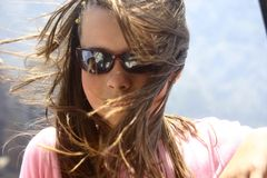 Hair on wind. Girl with long hair during travel Royalty Free Stock Photo
