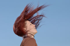 Hair. Woman throwing her long hair Royalty Free Stock Photo